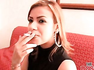 Latina In A Brief Miniskirt Smokes A Ciggie