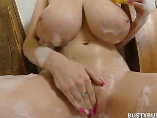 Voluptuous Honey Is Touching Her Soapy Baps And Fucking Her Rosy Slit