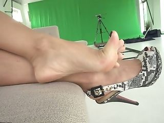 Nikky Thorne Gives A Superb Footjob And What A Nasty Whore She Is