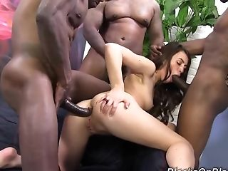 Pretty Dark Haired Tiffany Doll Fucked By Large Group Of Black Studs