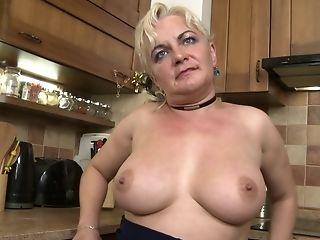 Matures Buxom Blonde First-timer Milena V. Strips In The Kitchen