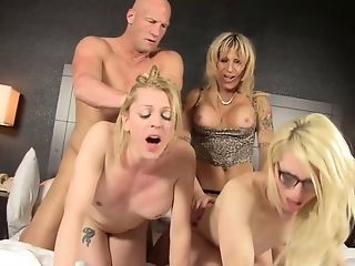 Two babes a hot shemale and a guy have a fun fucking orgy tmb