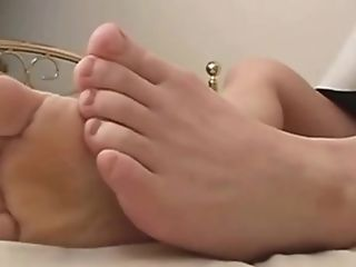 Beautiful Asian Loves Playing With Her Feet