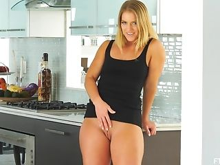 Blonde In High High-heeled Shoes And A Little Black Sundress Candice Strips At Home