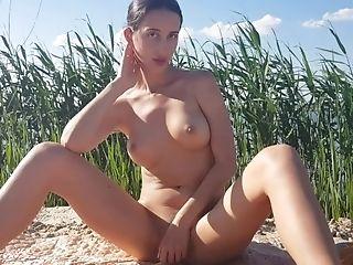 Woman Masturbating On The Beach