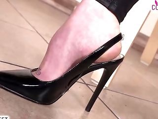Two Shoeless Red-haired Catwoman Shows Off Feet And Subjugate
